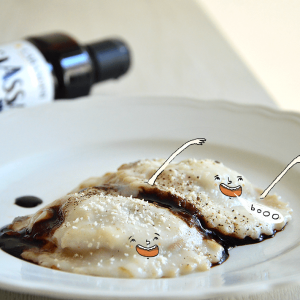Ravioli di zucca con crema di parmigiano e glassa all'aceto